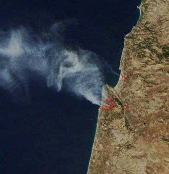 حريق الكرمل في صورة من القمار الصناعي التابع لناسا. هل تعرف ناسا الكرمل لمين؟؟